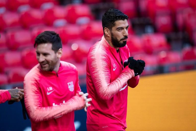 Lionel Messi et Luis Suarez à l'échauffement.